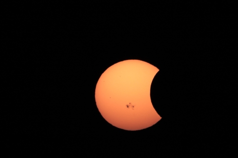 Partial Eclipse with Visible Sunspot